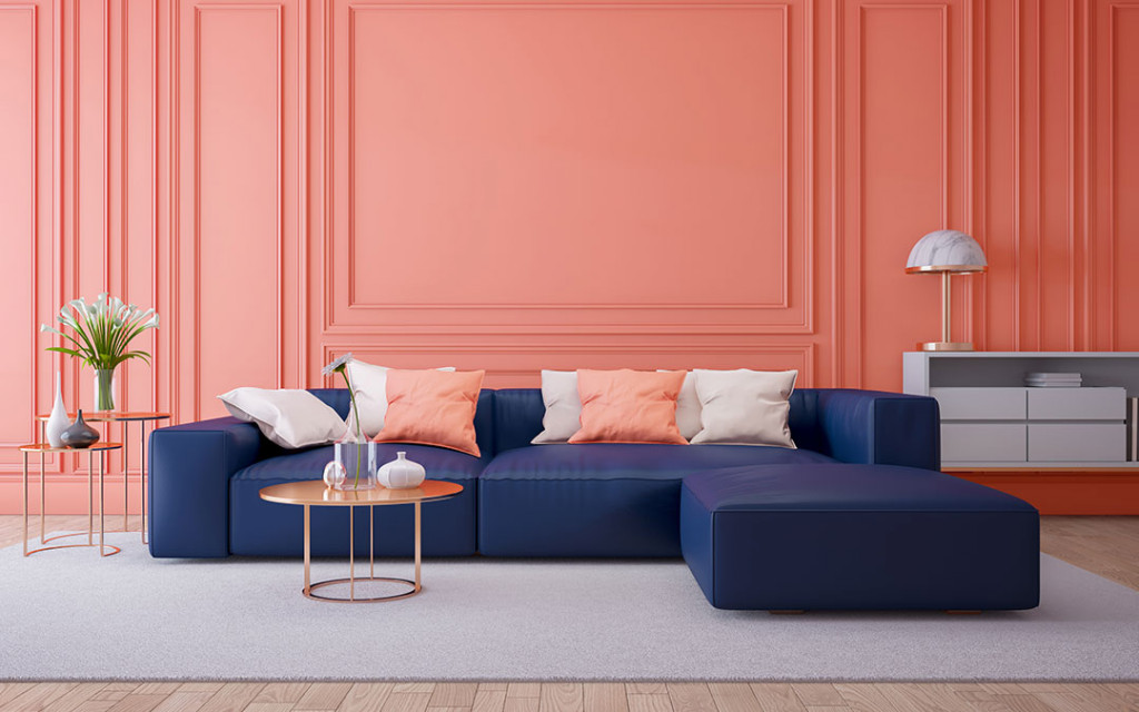 A-living-room-Costal-blue-colour-shofas-and-wall-painted-with-Coral