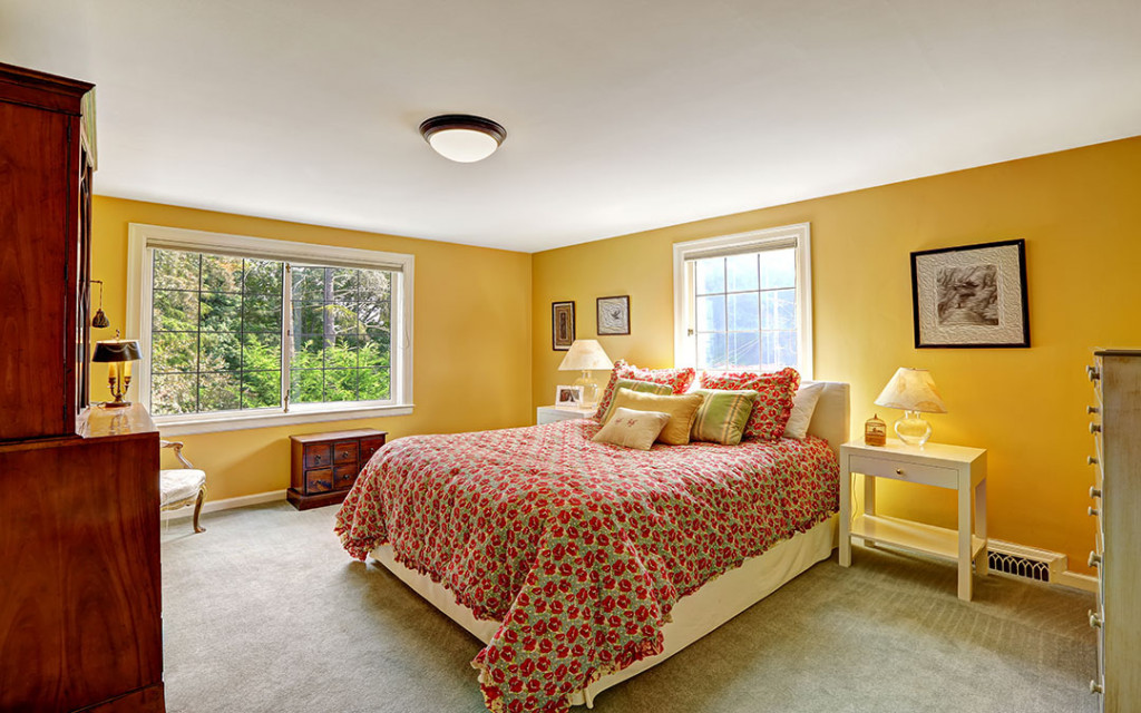 Bedroom-walls-painted-with-yellow-colour