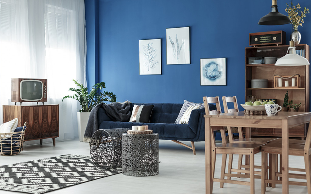 living-room-coloured-with-dark-blue-and-decorated-by-wall-frames