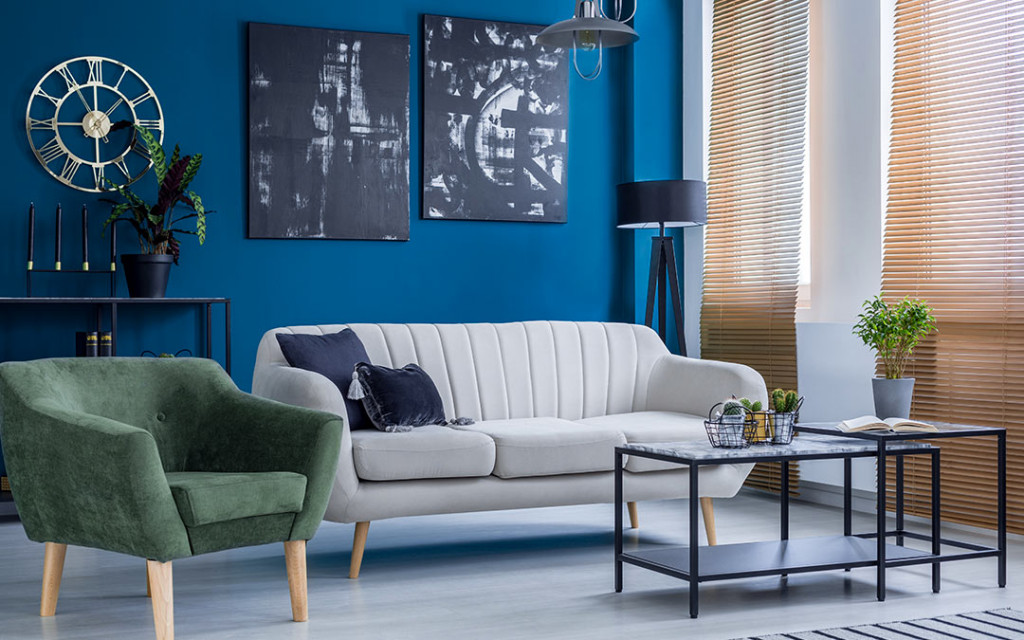Modern-living-room-have-sofas-and-wall-frames-painted-with-blue-colour